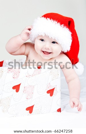 Santa baby with a gift