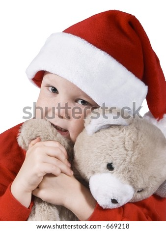 santa boy hugging a bear