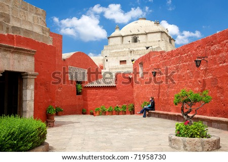 Santa Catalina white church with red wall & blue sky