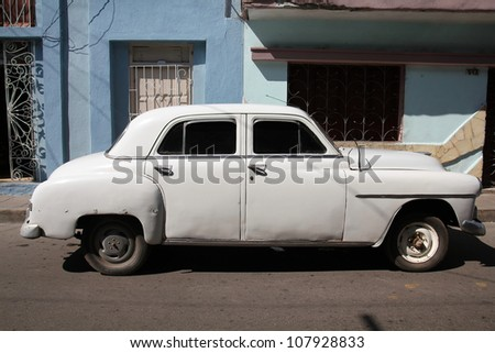 SANTA CLARA, CUBA - FEBRUARY 21: Classic American car on February 21, 2011 in Santa Clara, Cuba. Recent law change allows the Cubans to trade cars again. Old law resulted in very old cars in Cuba.