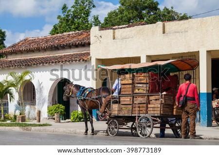 Shutterstock SANTA CLARA, CUBA - JUNE 25, 2015: Street trader on the street in the revolution city Santa Clara Cuba