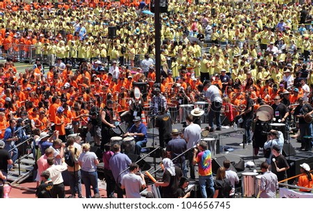 SANTA CLARITA, CA - MAY 18: Over 10,000 sixth and seventh graders break the world record for the largest drum circle on May 18, 2012 in College of the Canyons, Santa Clarita CA, USA.