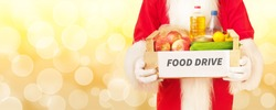 Santa Claus and a box with food. Christmas donation concept