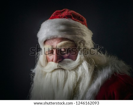 Santa Claus and Santa Claus on a black background. Santa Claus and Santa Claus are majestic and original on a black background. #1246162093