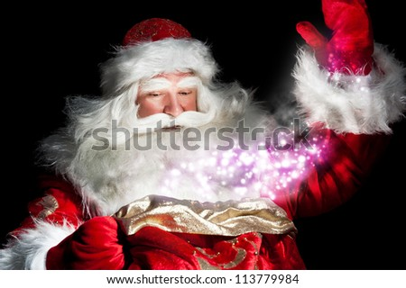 Santa Claus at home at night making magic