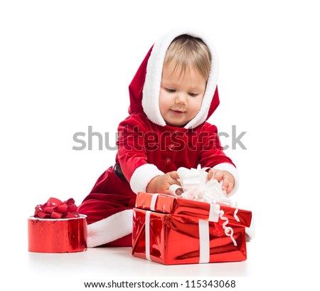 Santa Claus baby girl opening gift box isolated on white background - stock photo