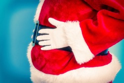 Santa Claus belly on blue background
