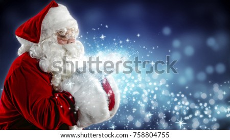 Santa Claus blows snow