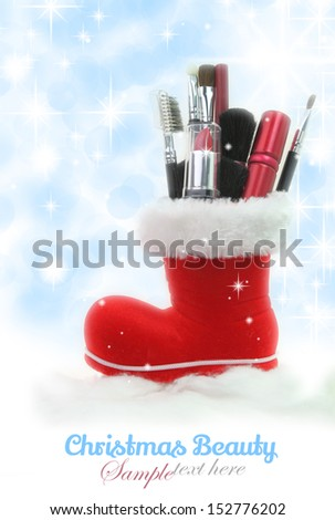 Santa Claus boot stuffed with woman cosmetics