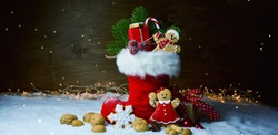 Santa Claus boots - St Nicholas boots with gingerbread man and gift box - Christmas background banner