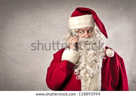 Santa Claus calling with a mobile phone