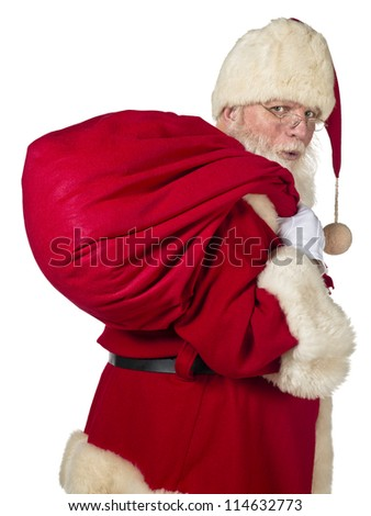 Santa Claus carrying big bag on a side view image