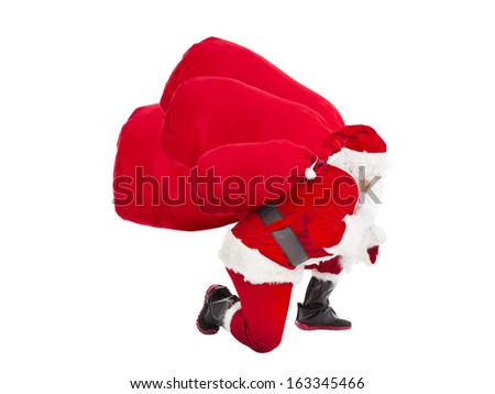 santa claus carrying heavy gift bags - Shutterstock ID 163345466