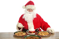 Santa Claus. Christmas Santa. Isolated on white. Room for text. Santa Claus holds a cup of Hot Coco with a Candy Cane and Whip Cream. Santa Loves Hot Coco and Cookies on Christmas. Merry Christmas.