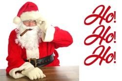 Santa Claus Christmas. Santa smokes a Cigar and says Ho! Ho! Ho! while relaxing at a table as he plans his route to deliver presents to good boys and girls this Christmas. Merry Christmas to all.