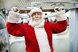 Santa Claus  doing exercise on machine at gym