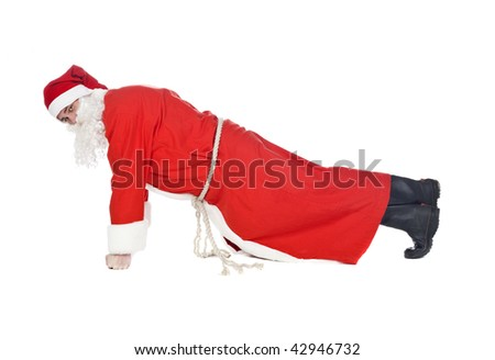 Santa claus doing push-ups isolated on a white background - Shutterstock ID 42946732