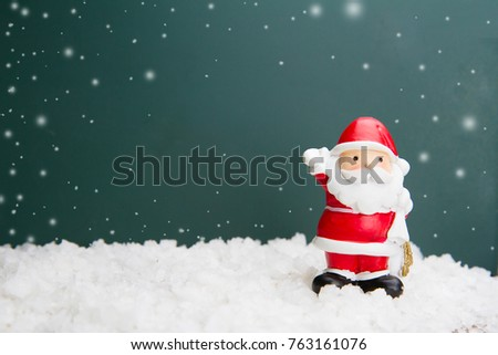 Santa Claus Doll on black bord for copy space - Shutterstock ID 763161076