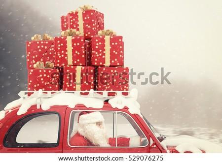 stock photo santa claus drives a red car full of christmas present 529076275 - Каталог — Фотообои «Ретро»