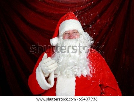 Santa Claus enjoys fresh falling snow while he prepairs for the Christmas Rush
