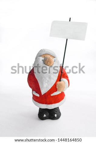 Santa Claus figur holding a blank sign in his hand