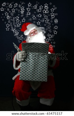 "Santa Claus fills a Christmas Present with ""Christmas Magic"" and love for everyone around the world. The bright light of Christmas Magic lights up santa's face from inside the box"