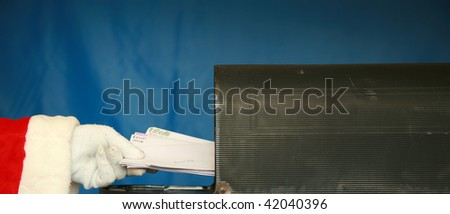 Santa Claus gets his mail from his mail box - stock photo