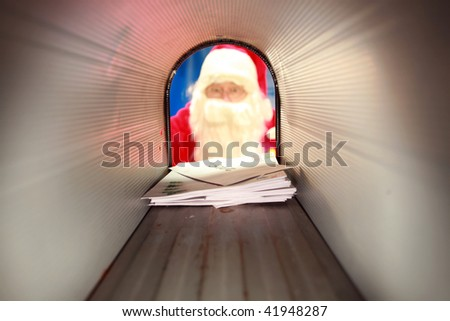 Santa Claus gets his mail from his mail box in the north pole before christmas eve