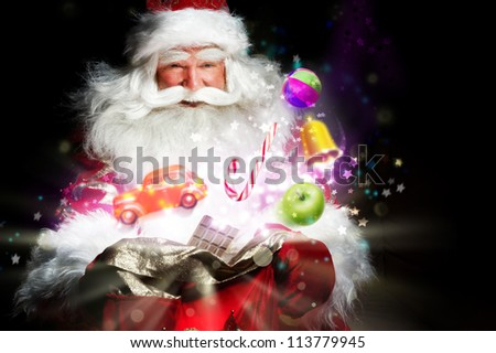 Santa Claus getting gifts and confection from his bag and showing miracle