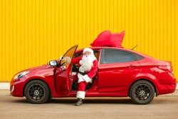 Santa Claus getting out of car outdoors