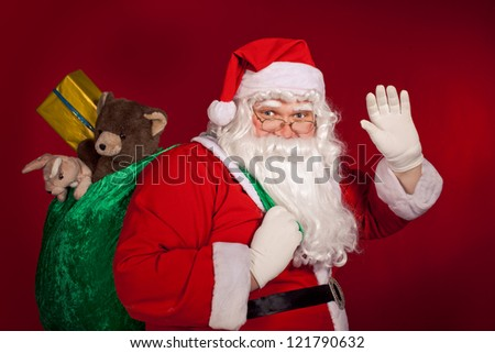Santa Claus greeting and holding his bag