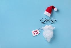 Santa Claus hat, glasses and beard. Christmas or New year greeting card. Secret Santa concept.