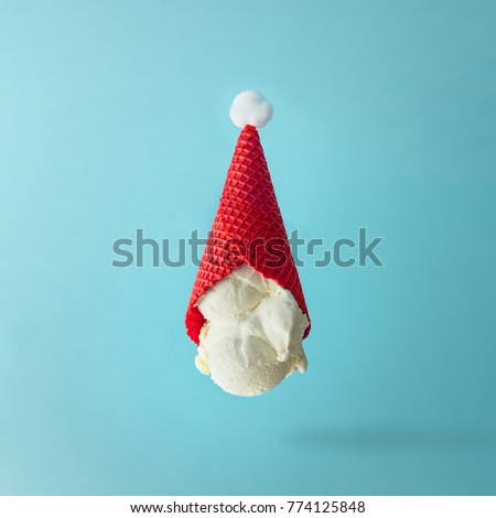 Santa Claus hat made of upside down vanilla ice cream. Christmas holiday minimal concept.