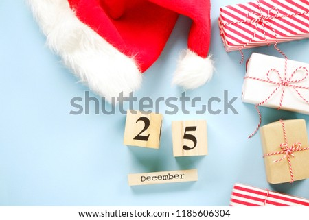 1422f042019f8 Santa Claus hat   new year presents wrapped in festive colorful craft paper  and silk bow