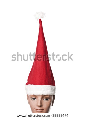 Santa claus hat on a doll isolated on a white background - stock photo