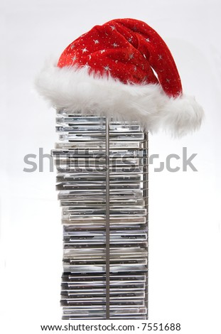 Santa Claus hat on compact disc stand isolated on white background