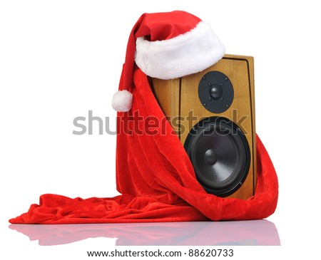 Santa Claus hat on the speaker in the red bag on white background