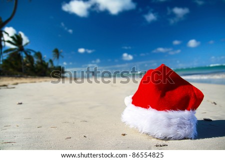 Santa Claus hat on tropical beach, closeup