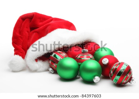 Santa Claus hat with balls on white background - stock photo