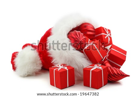 Santa Claus hat with Christmas presents and ornaments isolated on white background