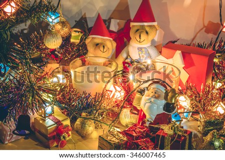 Santa claus hold bell and christmas candle, couple teddy bears and Ornament decorate Merry Christmas and happy new year