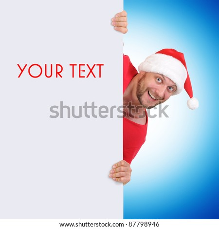 Santa Claus holding a blank for your text or image