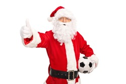 Santa Claus holding a football and giving a thumb up isolated on white background