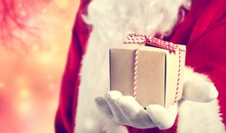 Santa Claus holding a present in his hand