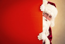 Santa Claus holding banner blank. Christmas holiday concept