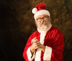 Santa Claus holding hands together