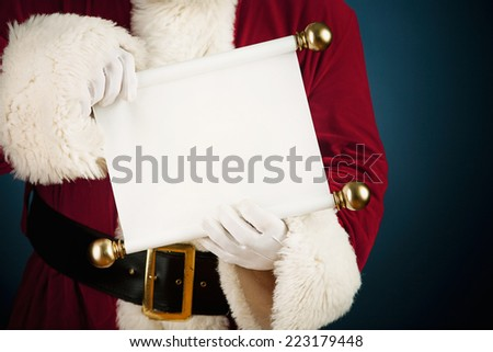 Santa Claus: Holding Out Blank Paper Scroll To Camera