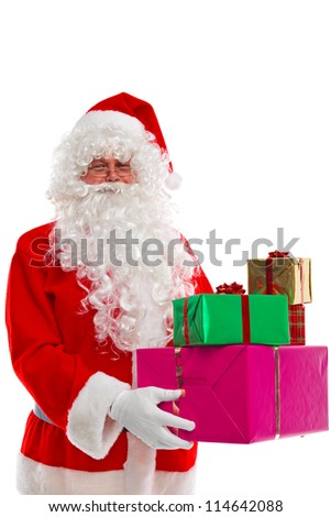 Santa Claus holding some Christmas presents, isolated on a white background.