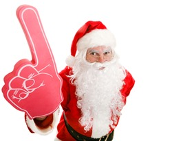Santa Claus holding up a number one foam finger.  Isolated on white.