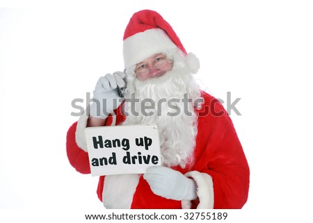 """santa claus holds a """"hang up and drive"""" sign and a cell phone           isolated on white     with room for your text"""